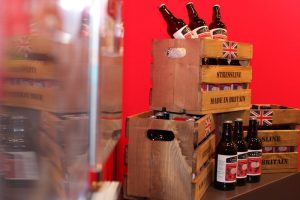 Literature stand and beer crate